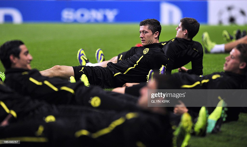Borussia Dortmund's Polish striker Robert Lewandowski attends a training session at the Emirates Stadium, North London, on October 21, 2013, on the eve of his team's UEFA Champions League Group F football match against Arsenal. AFP PHOTO/GLYN KIRK