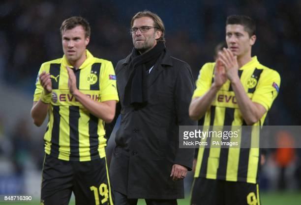 Borussia Dortmund's Robert Lewandowski and Kevin Grosskreutz applaud the fans after the final whistle as Borussia Dortmund manager Jurgen Klopp looks...
