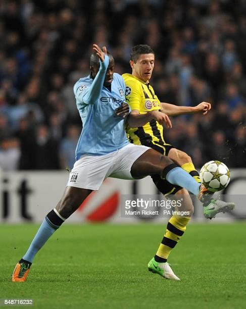 Borussia Dortmund's Robert Lewandowski and Manchester City's Yaya Toure battle for the ball