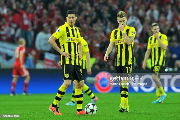 Borussia Dortmund's Robert Lewandowski and Marco Reus look dejected after Bayern Munich score their second goal of the game