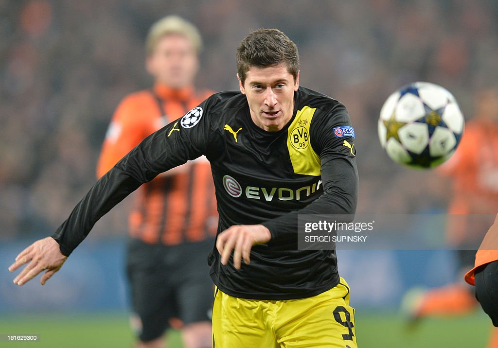 Borussia Dortmund's Robert Lewandowski looks at the ball during UEFA Champions League, Round 16, football match in Donetsk on February 13, 2013.
