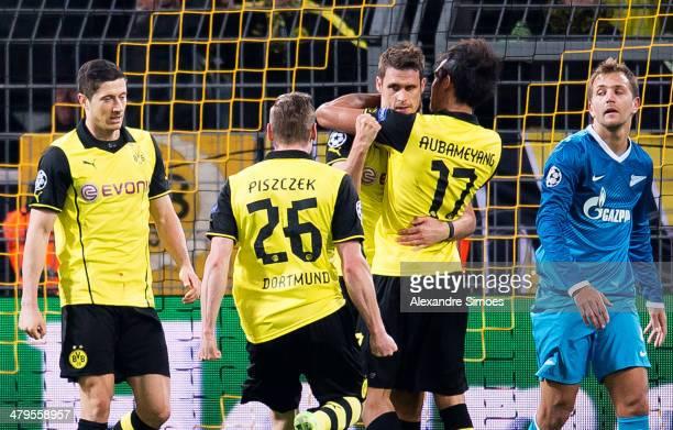Borussia Dortmund's Sebastian Kehl celebrates his goal with his team mates PierreEmerick Aubameyang Lukasz Piszczek and Robert Lewandowski during the...