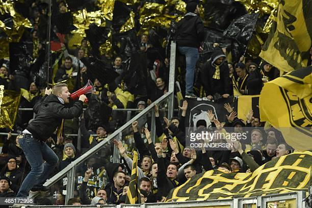 Borussia Dortmund's sfans shout slogans at the start of the German football Cup DFB Pokal round of 16 game between German third division Dynamo...