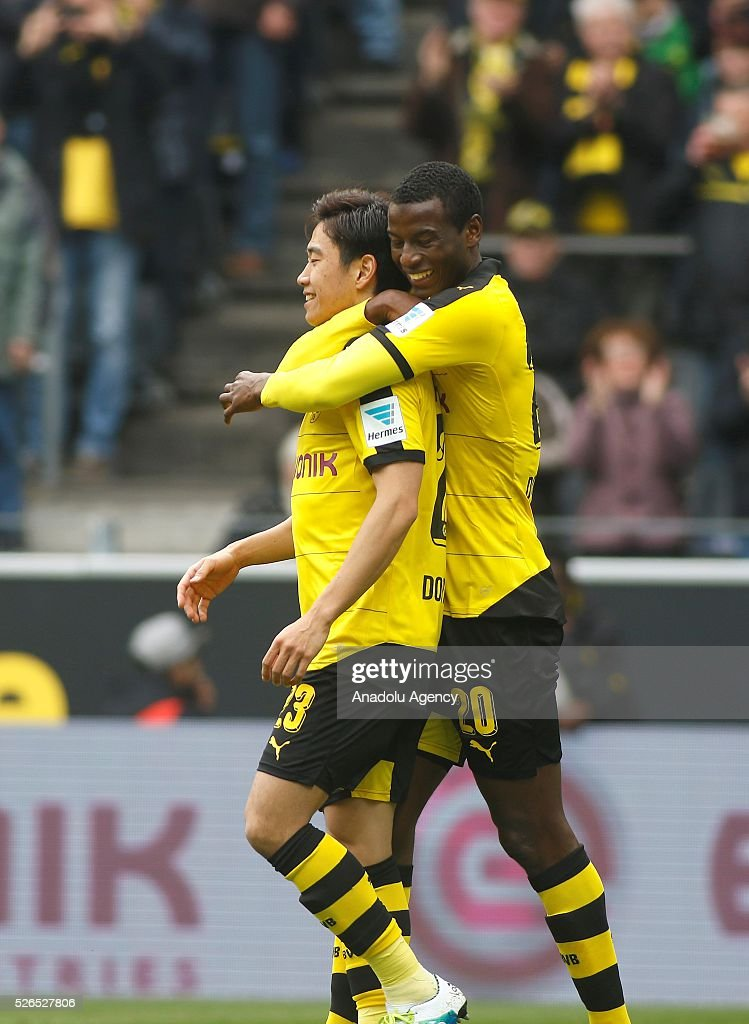 Borussia Dortmund's Shinji Kagawa and Adrian Ramos celebrate a goal during their Bundesliga soccer match between Borussia Dortmund and VfL Wolfsburg at the Signal-Iduna stadium in Dortmund, Germany on April 30, 2016.