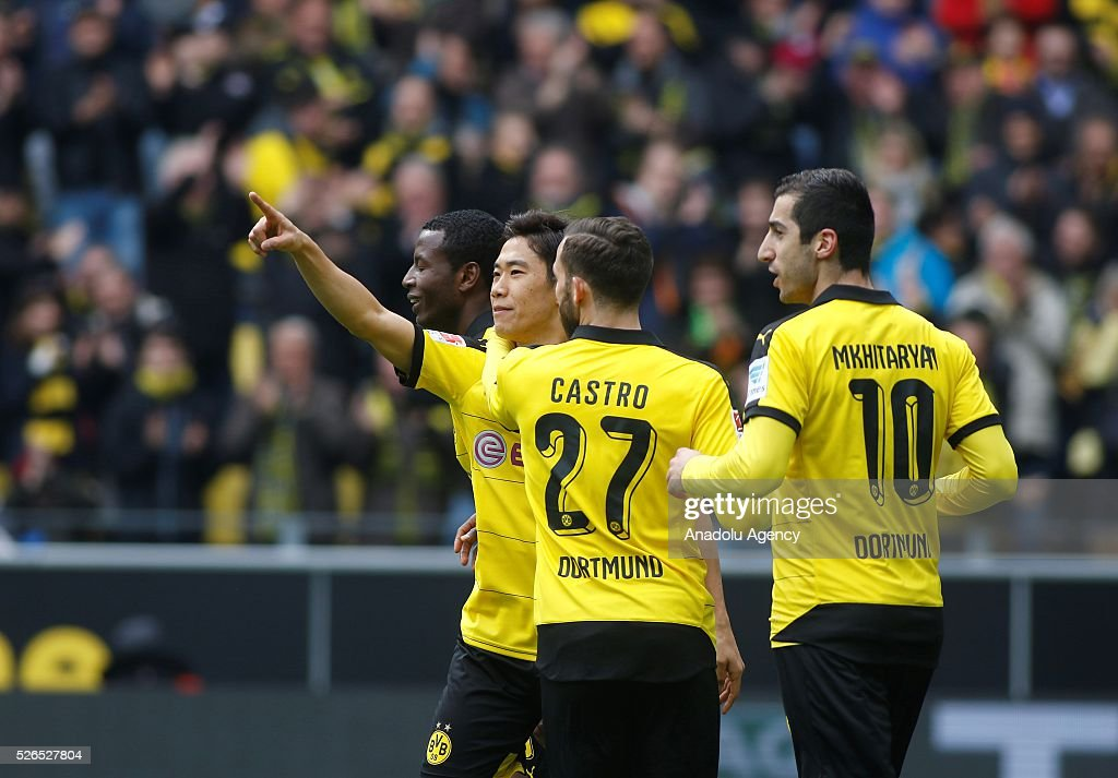 Borussia Dortmund's Shinji Kagawa, Gonzalo Castro and Henrikh Mkhitaryan celebrate a goal during their Bundesliga soccer match between Borussia Dortmund and VfL Wolfsburg at the Signal-Iduna stadium in Dortmund, Germany on April 30, 2016.