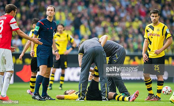 Borussia Dortmund's Shinji Kagawa is having a muscle cramp during the Bundesliga match between SC Freiburg and Borussia Dortmund at Signal Iduna Park...