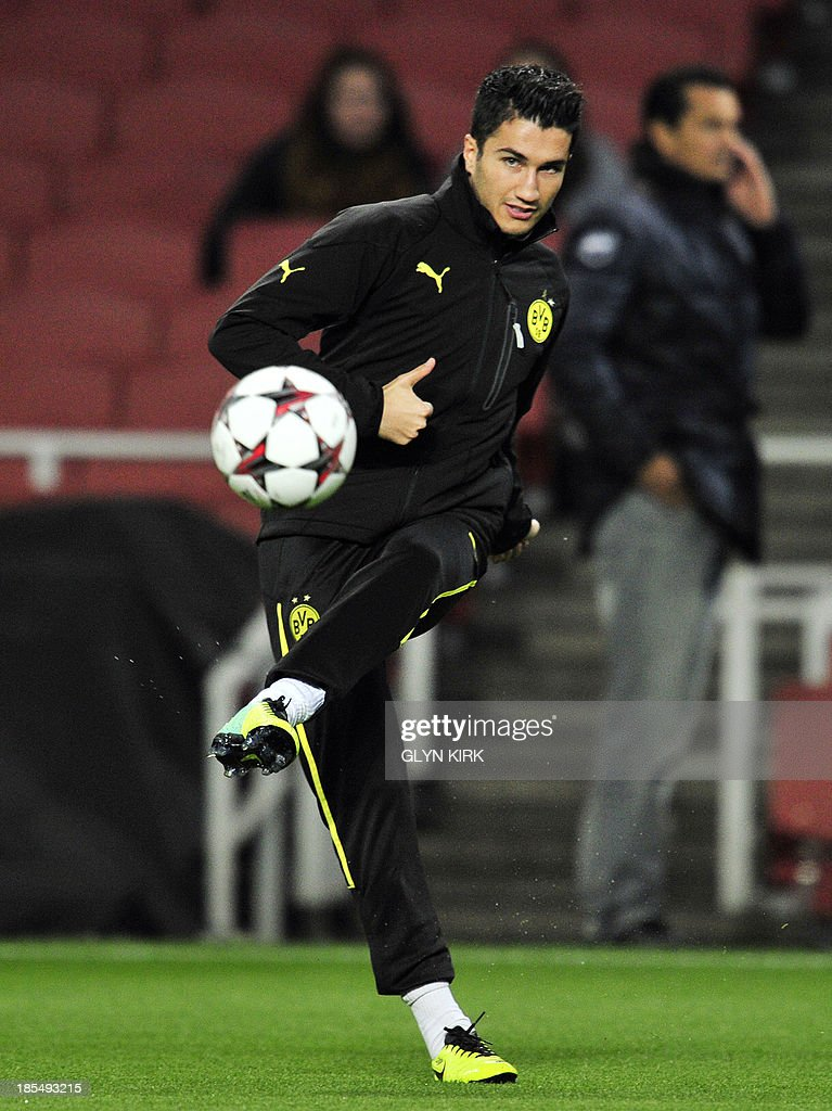 Borussia Dortmund's Turkish midfielder Nuri Sahin attends a training session at the Emirates Stadium, North London, on October 21, 2013, on the eve of his team's UEFA Champions League Group F football match against Arsenal.