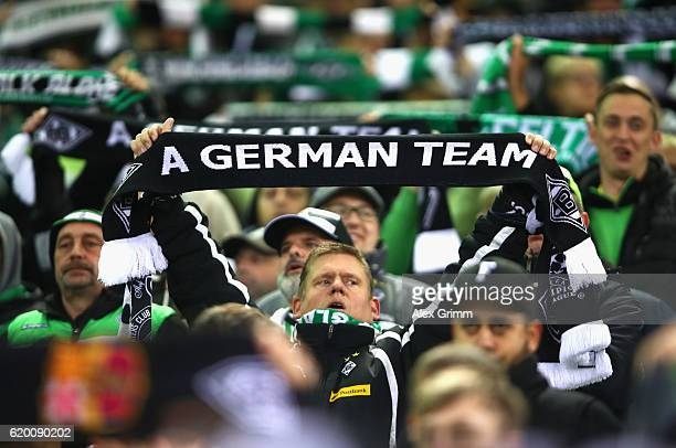 Borussia Moenchengladbach fan holds up a scarf reading 'A German team' prior to kick off during the UEFA Champions League Group C match between VfL...