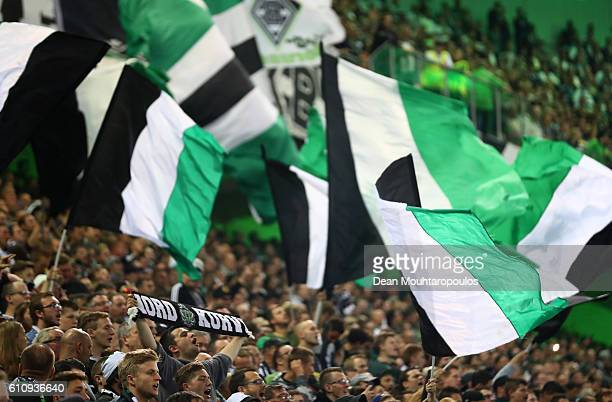 Borussia Moenchengladbach fans show their support during the UEFA Champions League group C match between VfL Borussia Moenchengladbach and FC...