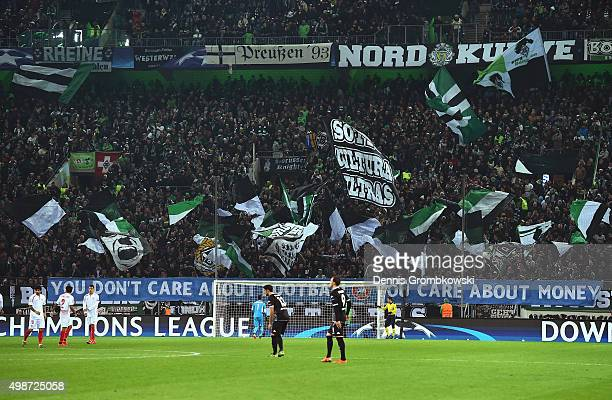 Borussia Moenchengladbach fans wave flags in support during the UEFA Champions League Group D match between Borussia Moenchengladbach and Sevilla at...