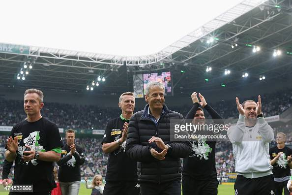 Borussia Moenchengladbach Manager / Head Coach Lucien Favre and his support staff celebrate with the fans after the Bundesliga match between Borussia...