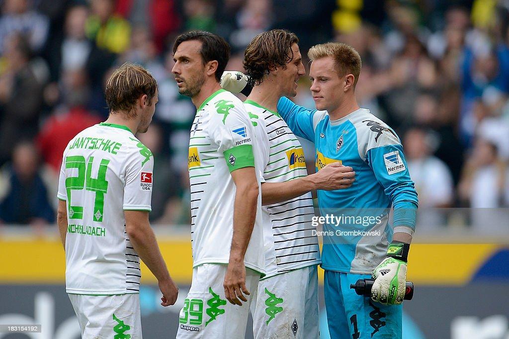 Borussia Moenchengladbach players celebrate victory in the Bundesliga match between Borussia Moenchengladbach and Borussia Dortmund at Borussia-Park on October 5, 2013 in Moenchengladbach, Germany.