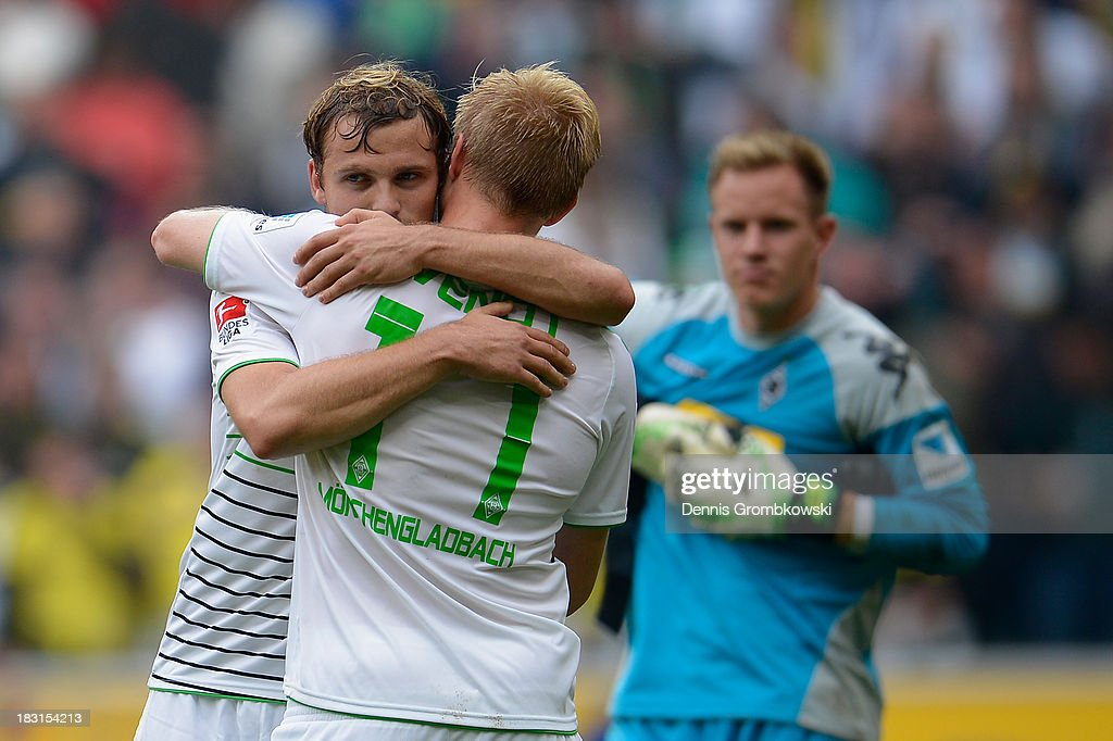 Borussia Moenchengladbach players <a gi-track='captionPersonalityLinkClicked' href=/galleries/search?phrase=Tony+Jantschke&family=editorial&specificpeople=4158344 ng-click='$event.stopPropagation()'>Tony Jantschke</a> and Oscar Wendt celebrate victory in the Bundesliga match between Borussia Moenchengladbach and Borussia Dortmund at Borussia-Park on October 5, 2013 in Moenchengladbach, Germany.