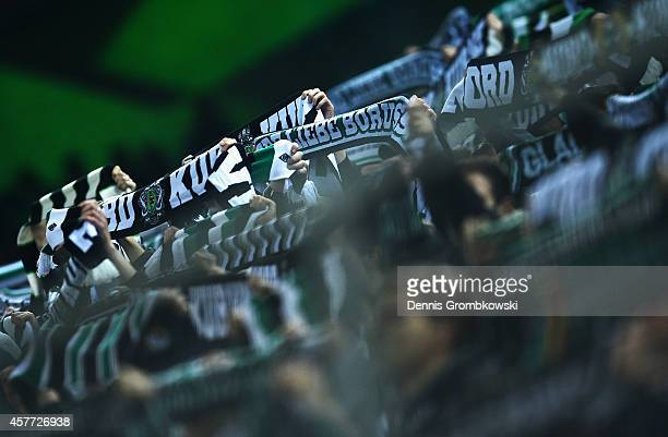 Borussia Moenchengladbach supporters present their scarfs during the UEFA Europa League group stage match between Borussia Moenchengladbach and...