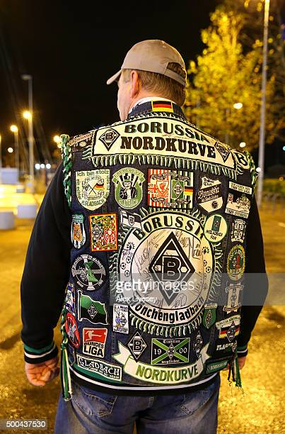 Borussia Monchengladbach fan displays his jacket covered in football patches prior to the UEFA Champions League Group D match between Manchester City...
