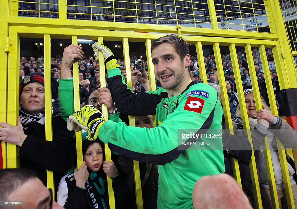 Borussia Monchengladbach's goalkeeper Christofer Heinmeroth celebrates with supporters after winning the UEFA Europa League football match against Fenerbahce SK on December 6, 2012 at Sukru Saracoglu Stadium in Istanbul.