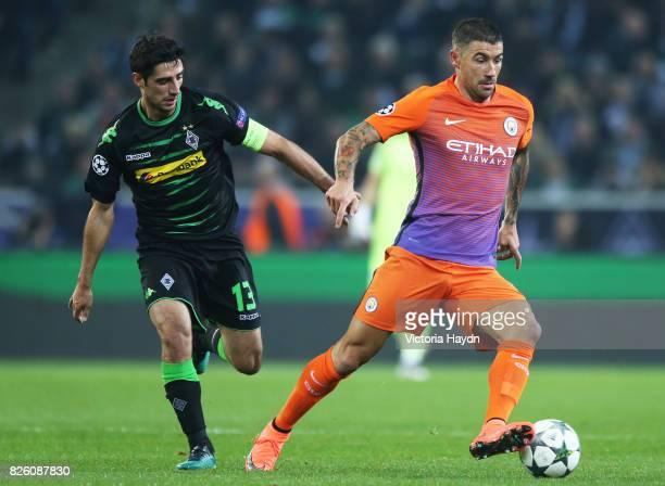 Borussia Monchengladbach's Lars Stindl and Manchester City's Aleksandar Kolarov battle for the ball