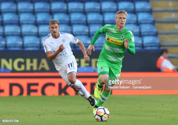 Borussia Monchengladbach's Oscar Wendt and Leicester City's Marc Albrighton during the preseason friendly match between Leicester City and Borussia...
