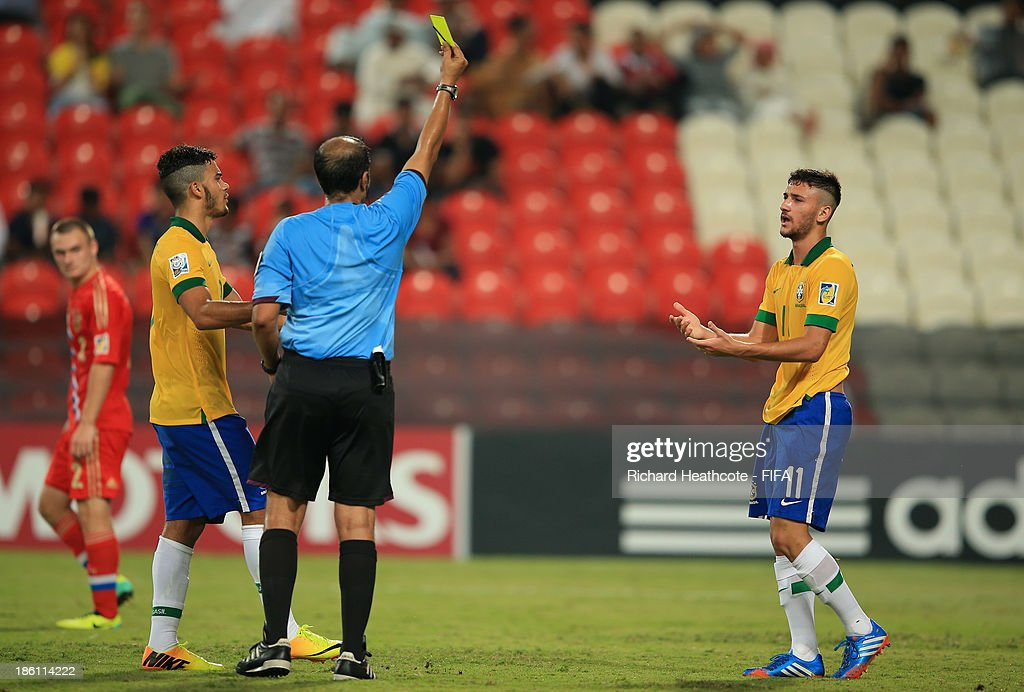 Boschilia of Brazil receives a yellow card during the FIFA U-17 World Cup UAE 2013 Round of 16 match between Brazil and Russia at the Mohamed Bin Zayed Stadium on October 28, 2013 in Abu Dhabi, United Arab Emirates.
