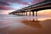 A sunset from Boscombe Beach looking over Boscombe Pier. Bournemouth.