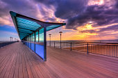 Boscombe Pier at sunset with brooding clouds