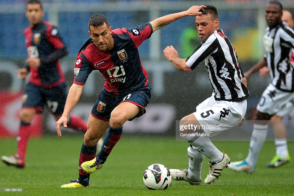 Bosko Jankovic of Genoa CFC fights for the ball with Calello of AC Siena during the Serie A match between Genoa CFC and AC Siena at Stadio Luigi Ferraris on March 30, 2013 in Genoa, Italy.