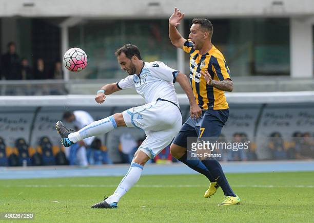 Bosko Jankovic of Hellas Verona competes with Santiago Gentiletti of SS Lazio during the Serie A match between Hellas Verona FC and SS Lazio at...