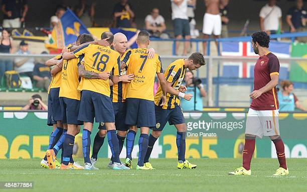 Bosko Jankovic of Hellas Verona is mobbed by team mates after scoring his opening goal during the Serie A match between Hellas Verona FC and AS Roma...