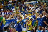 Bosnia and Herzegovina fans cheer during the 2014 FIFA World Cup Group F match between Nigeria and BosniaHerzegovina at Arena Pantanal on June 21...