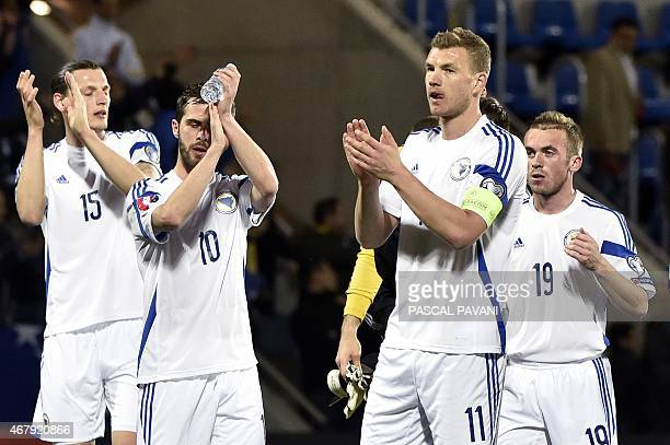 Bosnia and Herzegovina's forward Edin Dzeko jubilates with teammates at the end of the Euro Cup 2016 qualifying football match group D between...