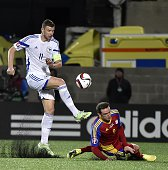 Bosnia and Herzegovina's forward Edin Dzeko vies with Andorra's forward Gabriel Riera during the Euro Cup 2016 qualifying football match group D...