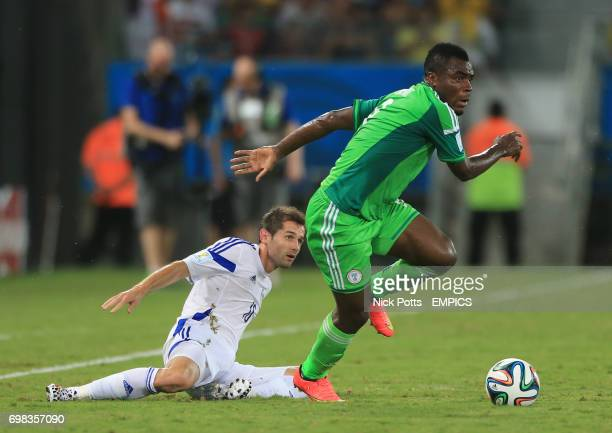 Bosnia and Herzegovina's Haris Medunjanin and Nigeria's Emmanuel Emenike battle for the ball