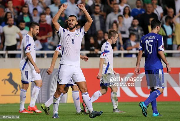Bosnia and Herzegovina's Haris Medunjanin celebrates after scoring a goal during the Euro 2016 qualifying football match against Cyprus on October 13...