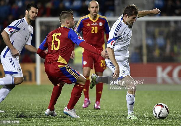 Bosnia and Herzegovina's midfielder Zoran Kvrzic vies with Andorra's midfielder Moises San Nicolas during the Euro Cup 2016 qualifying football match...