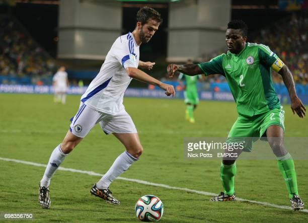 Bosnia and Herzegovina's Miralem Pjanic and Nigeria's Joseph Yobo in action
