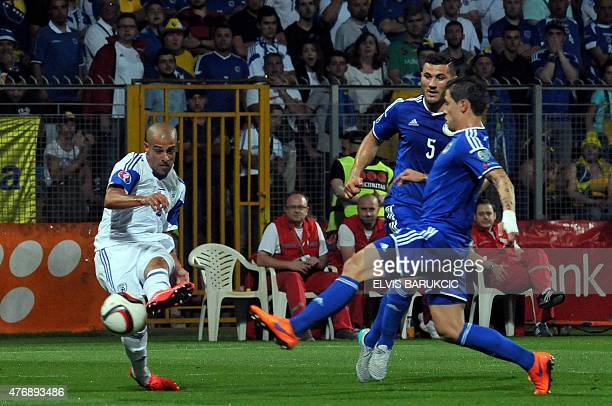 Bosnia and Herzegovina's Muhamed Besic and Sead Kolasinac vie with Israel's Tal Ben Haim during EURO 2016 qualifying match between Bosnia and...