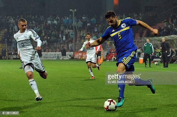 Bosnia and Herzegovina's Sead Kolasinac vies with Cyprus' Jason Demetriou during the FIFA WC2018 qualifying football match Bosnia and Herzegovina vs...