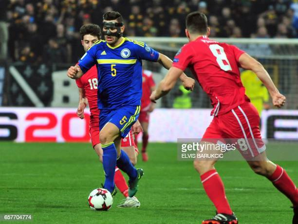 Bosnia and Herzegovina's Sead Kolasinac vies with Gibraltar's Aaron Payas and Gibraltar's Anthony Hernandez during the FIFA World Cup 2018...