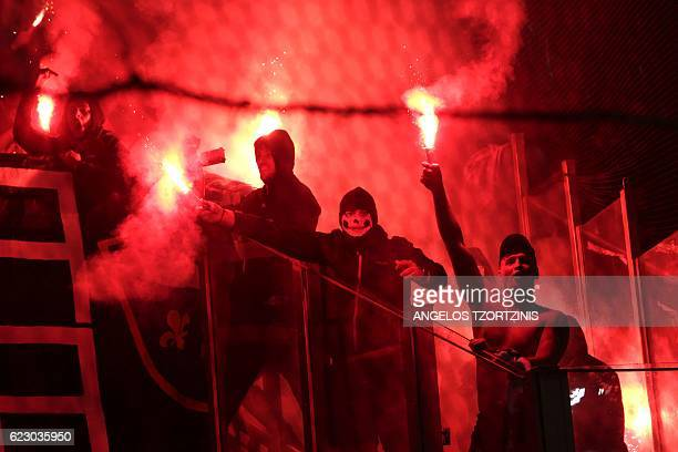 Bosnia and Herzegovina's supporters light flares during the 2018 World Cup football qualification match between Greece and Bosnia and Herzegovina at...