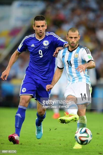 Bosnia and Herzegovina's Vedad Ibisevic and Argentina's Javier Mascherano in action