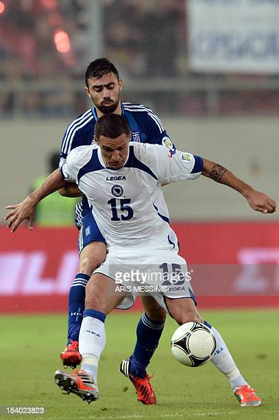 Bosnia Herzegovina's Sejad Salihovic fights for the ball with Greece's Giannis Maniatis during their 2014 World Cup qualification football game in...