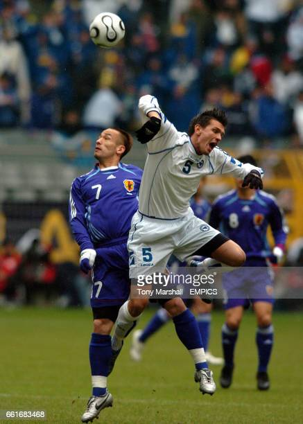 Bosnia Herzegovina's Zlatan Bajramovic and Japan's Hidetoshi Nakata