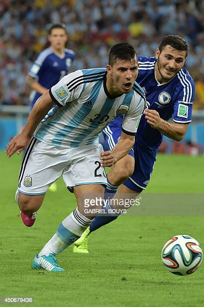 BosniaHercegovina's defender Sead Kolasinac challenges Argentina's forward Sergio Aguero during the Group F football match between Argentina and...