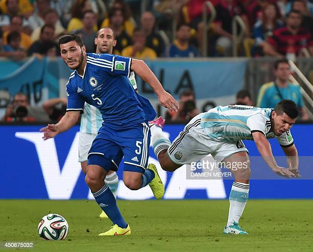 BosniaHercegovina's defender Sead Kolasinac fights for the ball with Argentina's forward Sergio Aguero during a Group F football match between...