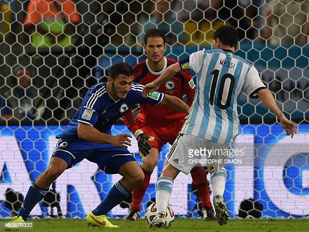 BosniaHercegovina's defender Sead Kolasinac fights for the ball with Argentina's forward and captain Lionel Messi during a Group F football match...