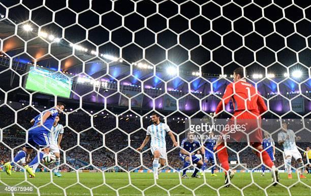 BosniaHercegovina's defender Sead Kolasinac kicks an own goal during a Group F football match between Argentina and BosniaHercegovina at the Maracana...