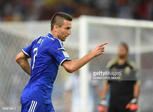 BosniaHercegovina's forward Vedad Ibisevic celebrates scoring during a Group F football match between Argentina and BosniaHercegovina at the Maracana...
