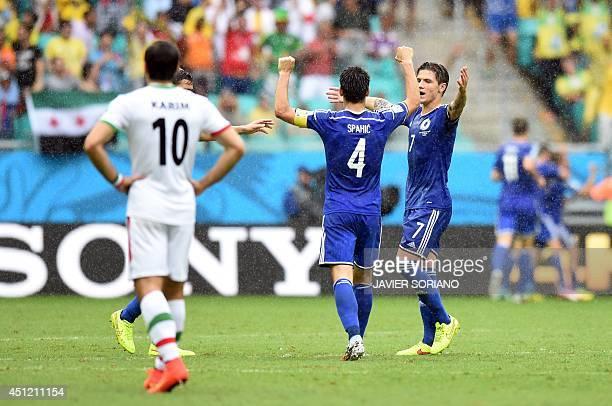 BosniaHerzegovina's defender Emir Spahic and BosniaHerzegovina's midfielder Muhamed Besic celebrate after BosniaHerzegovina's midfielder Avdija...