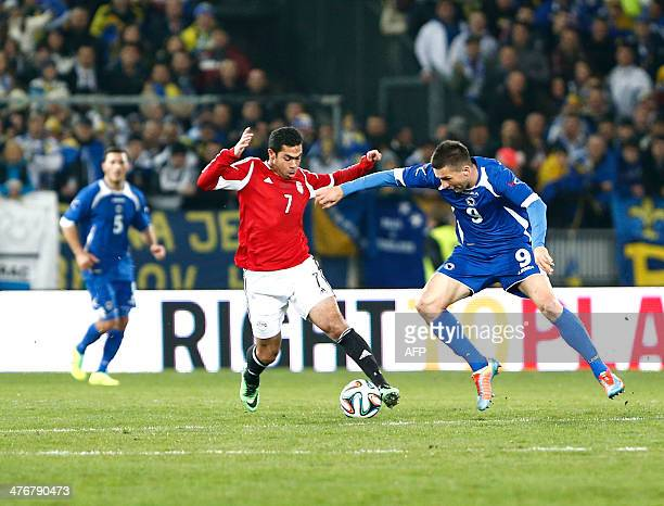 BosniaHerzegovina's Vedad Ibisevic fights for the ball with Egypt's Ahmed Fathy during the International friendly football match Bosnia and...