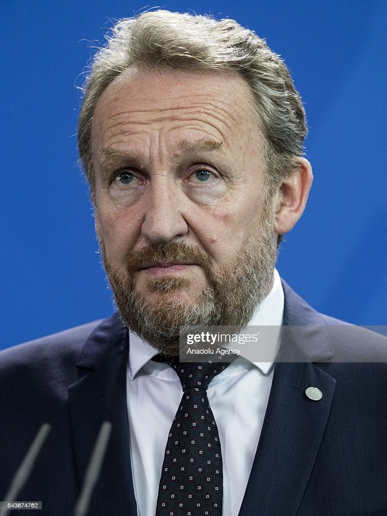 Bosniak Member of the Presidency of Bosnia and Herzegovina Bakir Izetbegovic (not seen), German Chancellor Angela Merkel (not seen), Former President of Bosnia and Herzegovina Mladen Ivanic (R) and Croat Member of the Presidency of Bosnia and Herzegovina Dragan Covic (not seen) hold a joint press conference following their meeting at the Federal Chancellery in Berlin, Germany on June 30, 2016.